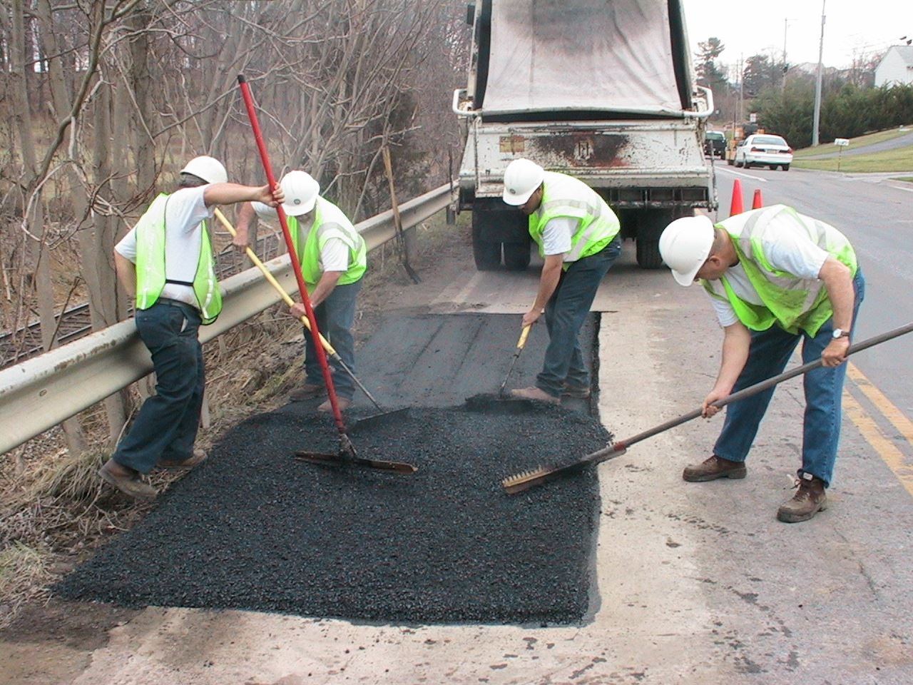 Street Maintenance Crew Laying Asphalt