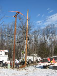 Energy Services Department work on an electrical pole.