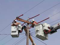 Workers repair a power line